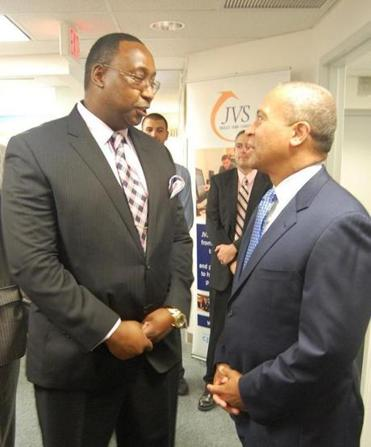 Malden resident Charles Mwangi (left) chats with Governor Deval Patrick during Tuesday's gathering in Boston.