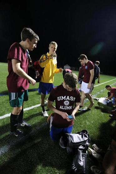 "Hadrien Vasdeboncoeur (from left), Aaron Fix, Zach Skole, and Elliott West play for Analysis Group's soccer team. They don't always win. ""We're not athletes,"" Skole said. ""We're economists."""