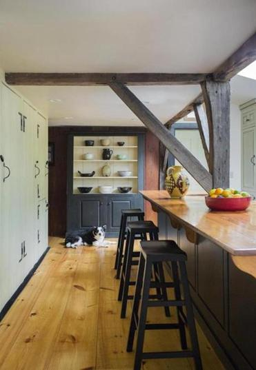 The kitchen has an island topped by re-purposed barn wood.
