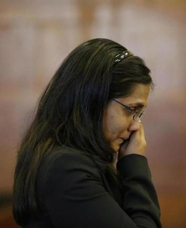 Annie Dookhan wiped tears from her face during a hearing at Suffolk Superior Court in Boston on Friday.