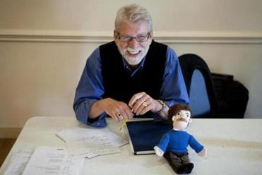 Director Cliff Fannin Baker, with a Kurt Vonnegut doll, at a rehearsal for the play.