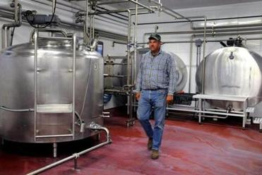 Owner John Hornstra walks through the milk processing center.