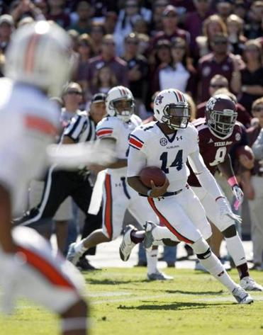 Auburn quarterback Nick Marshall accounted for four touchdowns in the Tigers' upset of No. 7 Texas A&M.