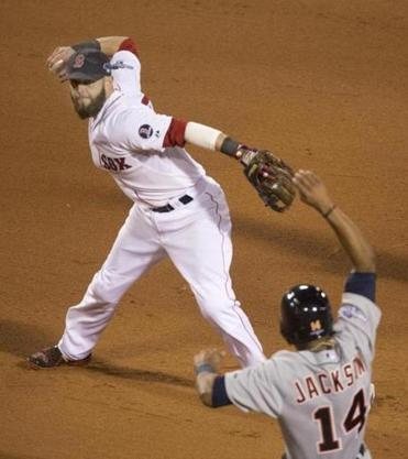 Dustin Pedroia turns at second to force Austin Jackson and fires to first to complete a double play in the fifth.