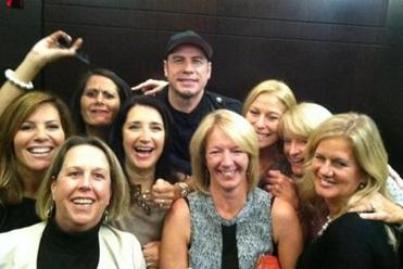Travolta with revelers (front, from left) Katie Toomey, Gill Barnard, Elaine McCarthy, (back, from left) Jan Aldrich, Sharyn Reilly, Janet Cali, Colleen Brescia, and Mary Lou Jackson at the Liberty Hotel Saturday.