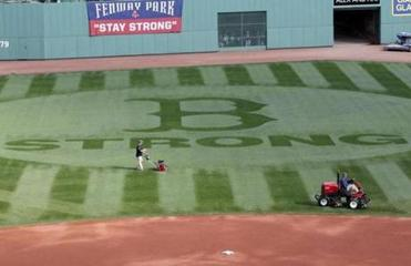 Fenway Park features a reminder in center field, fashioned by the groundskeepers, of the team's bonds with the city.
