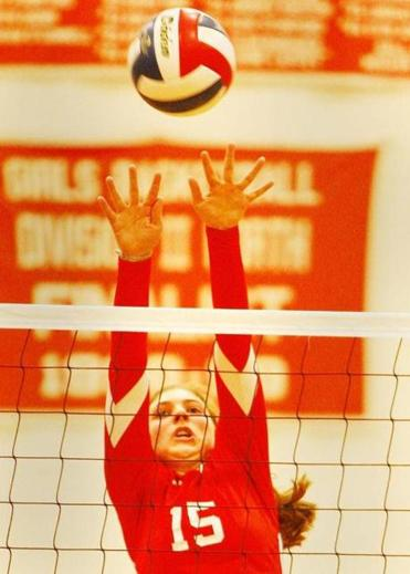 Melrose High's  Victoria Crovo  goes up to block a shot in the game with Burlngton High.