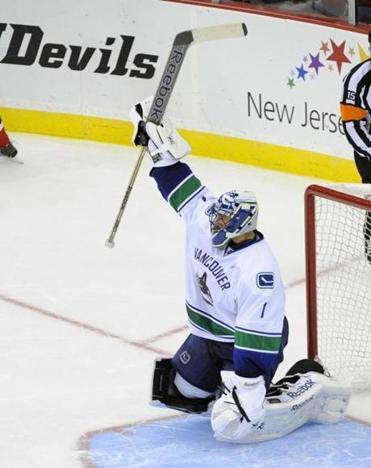 Canucks goalie Roberto Luongo stops a shot by the Devils' Patrik Elias during a shootout. The Canucks won, 3-2.