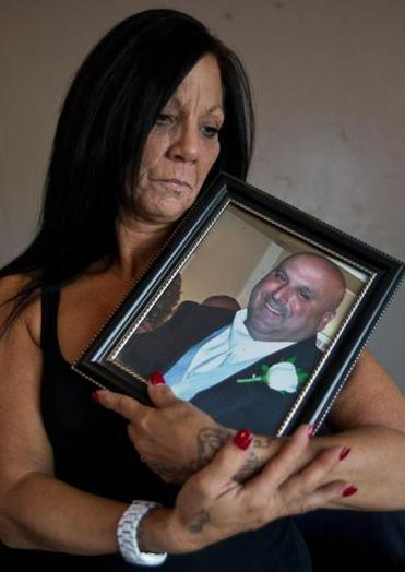Cheryl Ferullo held a photo of her husband, Scott Ferullo, 45, who died after open gastric bypass surgery last year.