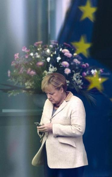 German Chancellor Angela Merkel using her cell phone at the chancellery in Berlin in 2011.