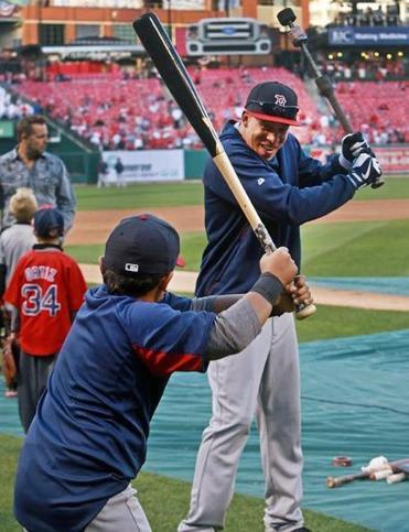 Quintin Berry gives David Ortiz's son D'Angelo batting tips before Game 5.