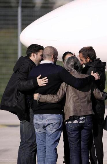 Former hostage Daniel Larribe (right) was greeted by his family Wednesday in France. He and three other Frenchmen were freed after being held since Sept. 10, 2010, by Al Qaeda militants.