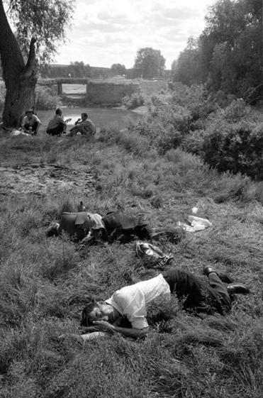 Drunk men asleep in the grass during a festival in June  2001 in the village of Baltaci, in the Tatarstan region of Russia.