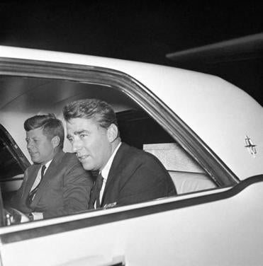 John F. Kennedy with brother-in-law and actor Peter Lawford.