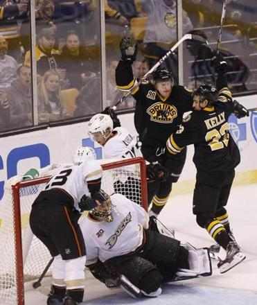 Chris Kelly reconnects with Carl Soderberg after Soderberg took Kelly's pass and put the puck behind goalie Jonas Hiller.