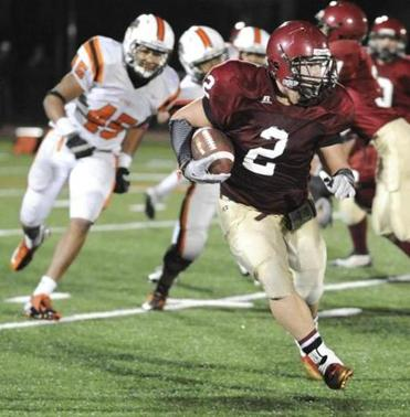 Gloucester's Jordan Pallazola carries against Beverly on Friday during Gloucester's 28-13 playoff victory.