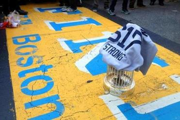 "The World Series trophy and a ""617 Boston Strong"" jersey designed by two Red Sox players were placed on the finish line."
