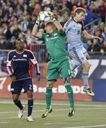 New England Revolution's Matt Reis (1) makes the save against Sporting Kansas City's Oriol Rosell in the second hal