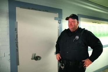 Officer John Tully guarded the room at Lawrence City Hall where the election ballots are being kept.