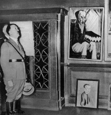 "Adolf Hitler examined works labeled  ""degenerate"" art by the Nazis at a display in Dresden in 1935."