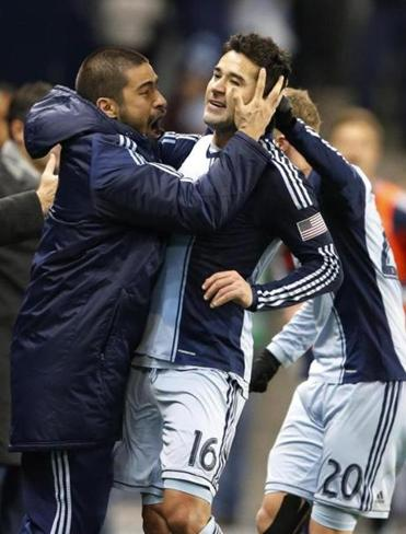Sporting KC forward Claudio Bieler (16) is congratulated by Paulo Nagamura (left) after Bieler's overtime strike.