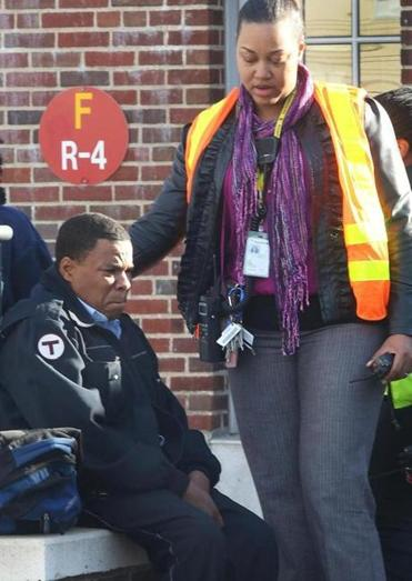 An MBTA worker comforted a train operator at the scene.