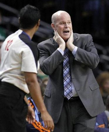 Bobcats coach Steve Clifford (right) was back on the bench Wednesday, not long after having two stents inserted in his heart.
