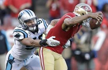 When tackling machine Luke Kuechly gets his hands on you, it's all over.(Marcio Jose Sanchez/Associated Press)