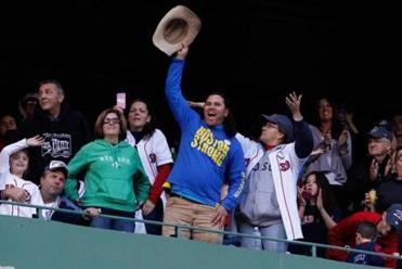 Carlos Arredondo stood and cheered at the start of the Red Sox World Series parade at Fenway Park. He has become the face of Boston Strong.