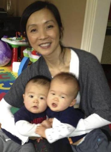 Mei Kum Jones of Arlington, with her twin boys, Colt and Cameron.