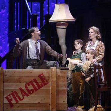 "From left: John Bolton, Jake Lucas, Noah Baird, and Erin Dilly star in the touring production of  ""A Christmas Story, the Musical."""