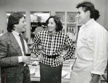 English with Michela Larson, who gave him his first big job, and Wolfgang Puck in 1986