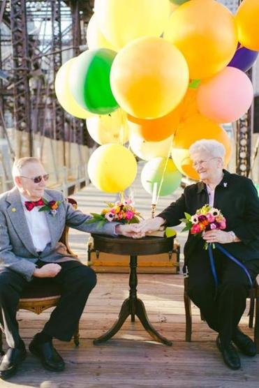 "Dorothy and Donald Lutz during their ""wedding"" photo shoot — with a theme inspired by the Pixar movie ""Up"" — on the Old Northern Avenue Bridge in Boston."