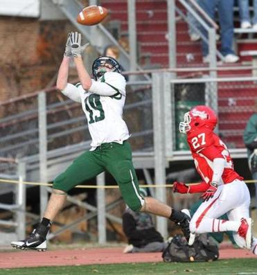 Mansfield's Brendan Hill, shown hauling in a pass from QB Kyle Wisnieski against Waltham in Division 2 state semifinals last November, is ahead of schedule after injuring his knee on Thanksgiving last fall and is expected to be ready for the start of practice.