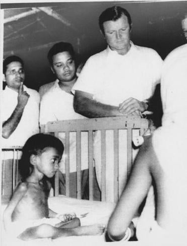 Senator Edward Kennedy visited a refugee child suffering from malnutrition during his fact-finding mission in Calcutta, India, in August 1971.