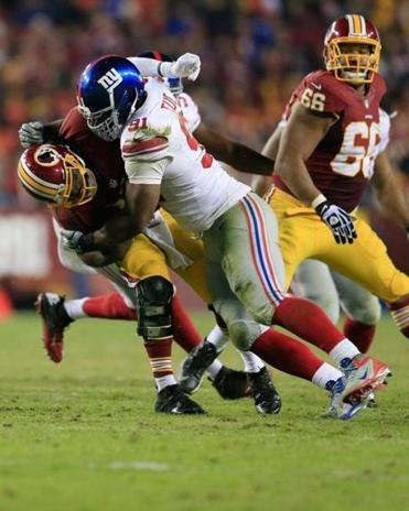 Giants defensive lineman Justin Tuck turned back the clock against the Redskins, registering 4 of the team's 5 sacks.