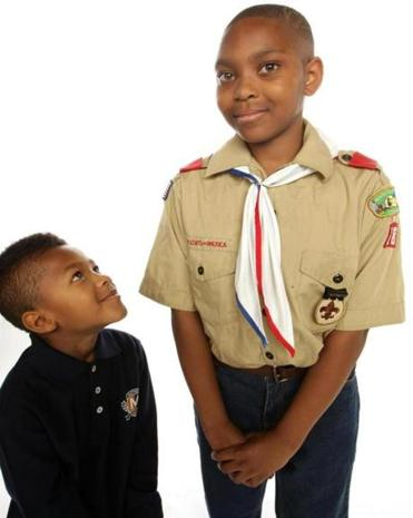 Kyle Ambrose (left) and Tiwan Bonner Jr. are among the growing ranks of Cub Scouts and Boy Scouts based in the city of Boston.