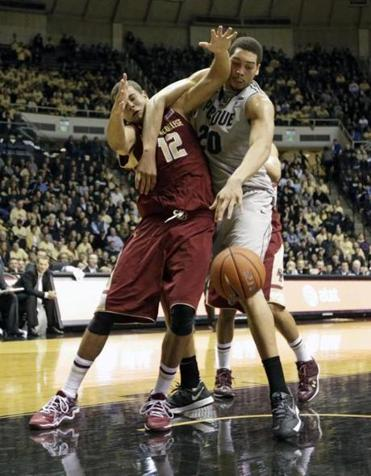 A.J. Hammons locked up BC forward Ryan Anderson as they go for a rebound.
