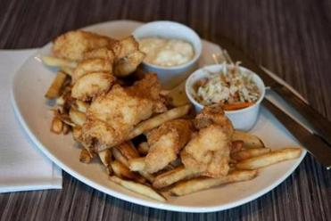 Fish and chips with cole slaw and tartar sauce.