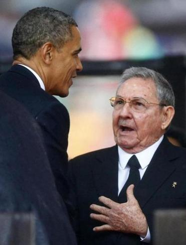President Obama greeted Cuban President Raul Castro before giving his speech at the memorial service for late South African President Nelson Mandela at the First National Bank soccer stadiumin Johannesburg, South Africa.