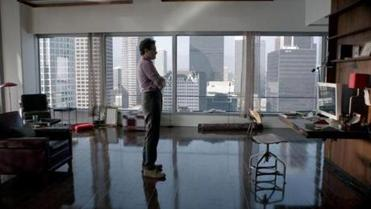 "Joaquin Phoenix plays Theodore, a man who falls in love with a voice (Scarlett Johansson) on his computer in Spike Jonze's new film ""Her."""