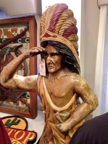This wooden Indian statue sold for $4,250 at the auction.