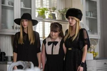 "From left: Taissa Farmiga, Jamie Brewer, and Emma Roberts in the episode ""Head"" from ""American Horror Story: Coven."""