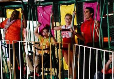 "Unique (Alex Newell), Artie (Kevin McHale), Kitty (Becca Tobin), and Blaine (Darren Criss) at a carnival in the ""Love Love Love"" 2013 premiere episode of ""Glee."""