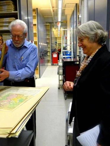 Caroline Sloat, the society's retired editor of publications, shows historical maps to Donald Eastlak of Milford.