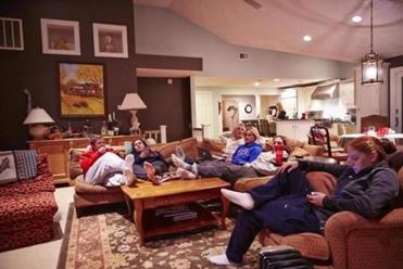 After burritos, Schleper, Bozek, twins Jocelyne and Monique Lamoureux, Vetter, and Schaus kick back at the Millers.