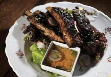 Lamb ribs dusted in cumin and deeply charred.