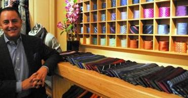 Marc Streisand, owner of the upscale men's store, Marc Allen Fine Clothiers.