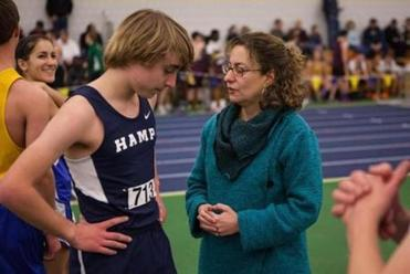 Karen Brown with son Sam during his track meet at Smith College in Northampton.
