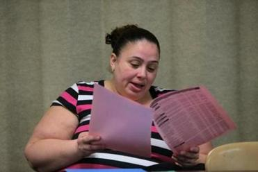Kimida Torres of Dorchester waited to register at a Boston schools welcoming center. She reviewed the options.